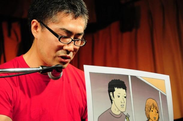 赤いシャツ姿が司会者とかぶってしまった古泉智浩。