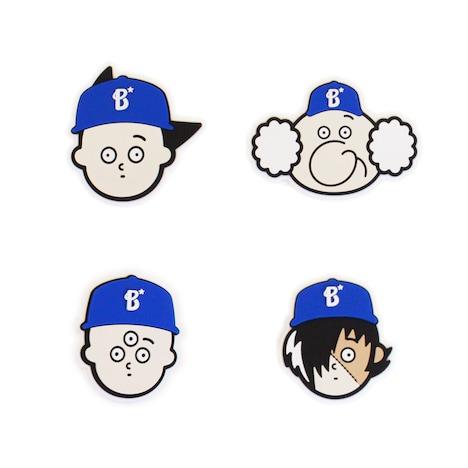 「手塚プロダクション×横浜DeNAベイスターズ PVCバッジ」は手塚キャラがベイスターズの帽子をかぶったデザイン。