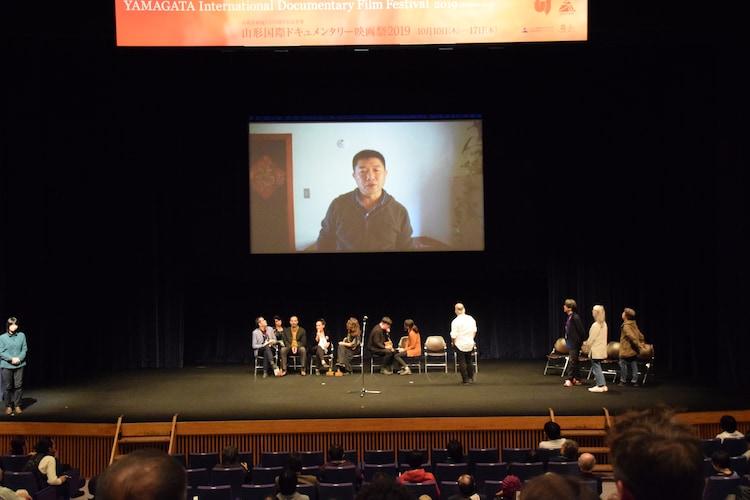 山形国際ドキュメンタリー映画祭2019の表彰式では、ワン・ビンによるビデオメッセージが上映された。(写真提供:山形国際ドキュメンタリー映画祭)