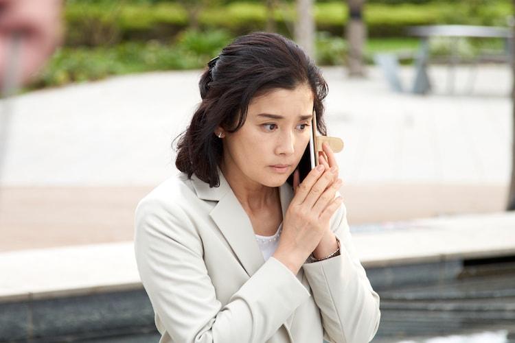 石田ひかり演じる花村玲子。