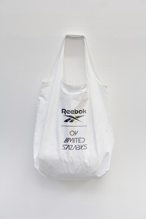 04 Limited Sazabys×リーボックコラボデザインのシューズバッグ。