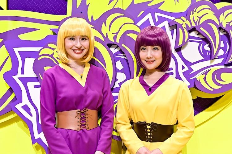 「メグ・ウガジン」こと宇賀神メグアナ(左)と「サヤ・ノムラ」こと野村彩也子アナ(右)。(c)TBS